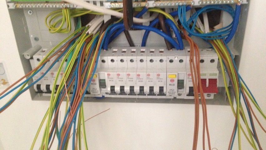 Cables awaiting termination in a new build Wylex board supplied by customer.